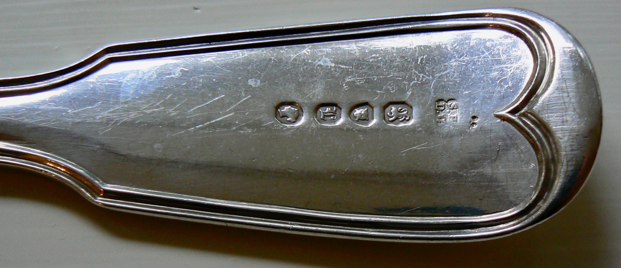 photo of silver hallmarks ready for estate and antique silver appraisal services by Jerry L. Dobesh, ASA